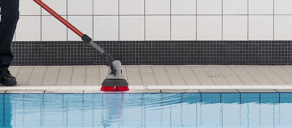 MotorScrubber M3 cleaning along the edge of a pool.