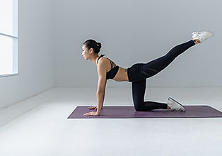 woman on floor doing yoga