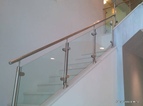 glass railing with metal clamps