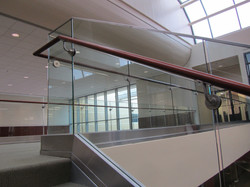 glass railing - wood handrail