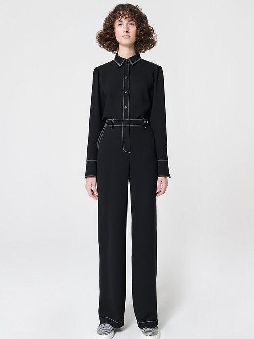 מכנסיים שחורים מבד רך תיפורים בולטים לבנים