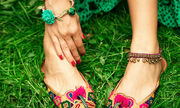 female legs on grass in leather ethnic b