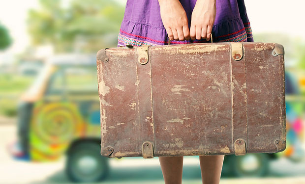 Hippie Girl With Old Suitcase On A Road