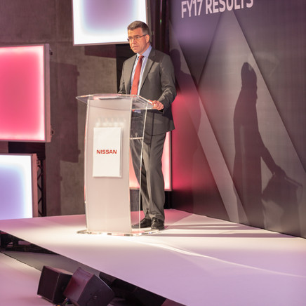 Nissan CEO On stage Giving A Talk