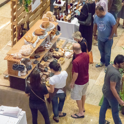 Ariel View Of People Buying Food From Bakery