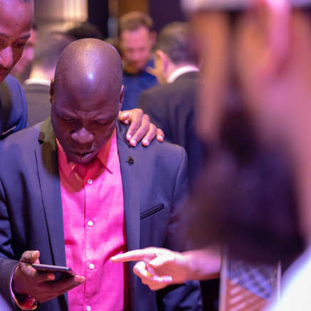 A Customer Testing Out The New Infinix Mobile Phone