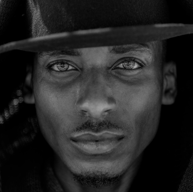 Male Model With Bowler Hat On