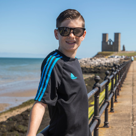 Boy Model Standing on Railings With A Big Smile