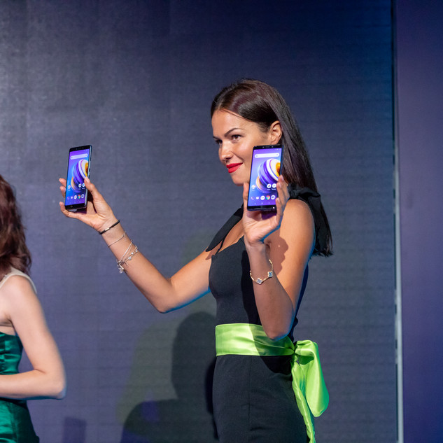 Lady Holding the New Infinix Mobile Phone On Stage