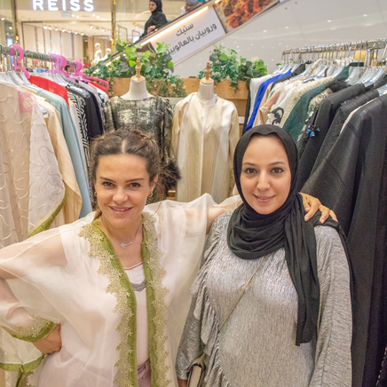 Fashion Stall With Owner Having A photo In front Of Her Stall