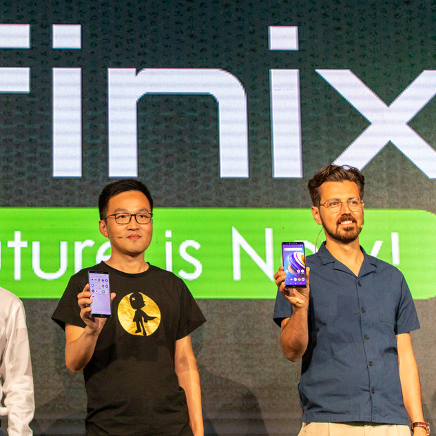 Guys On Stage Holding The New Infinix Mobiler Phone At The Launch Party