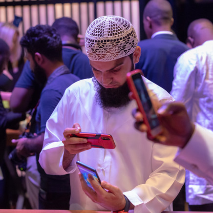 A Customer Taking A Photo Of The New Inifinix Mobile Phone
