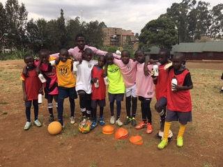 Grace Supports the Karama Academy Soccer Team