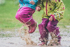 Children in rubber boots and rain clothe