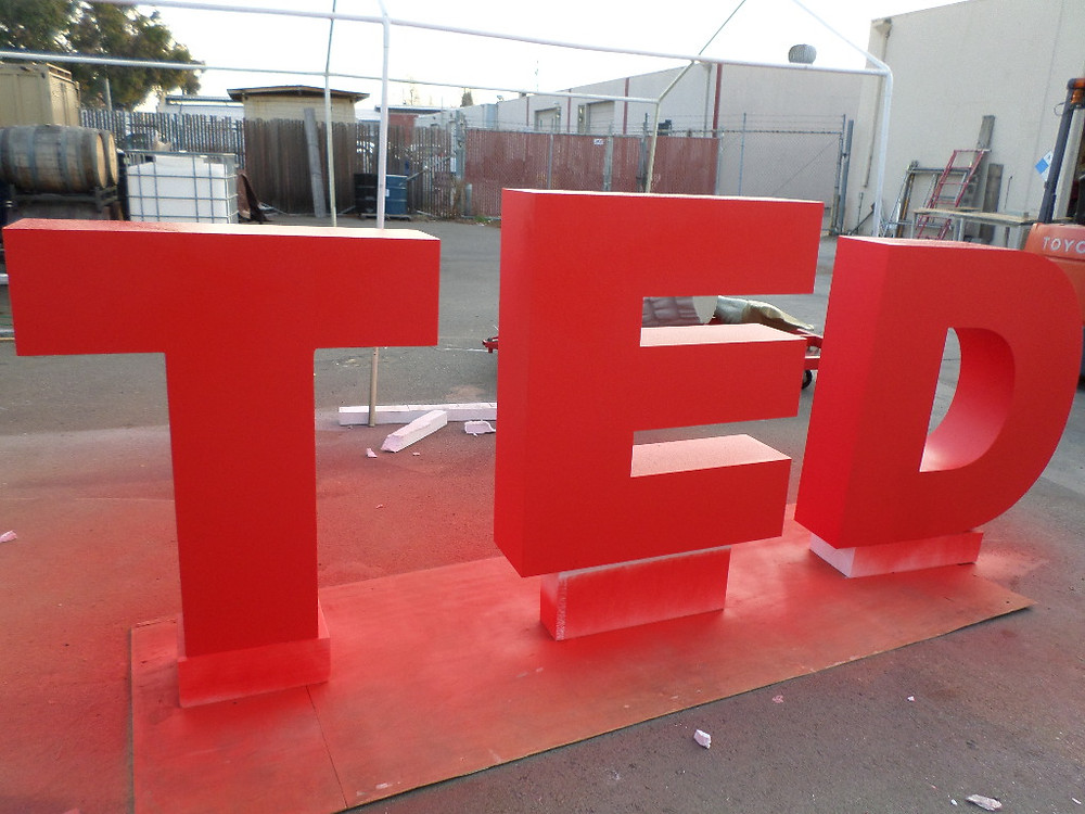 Red painted TED Letters