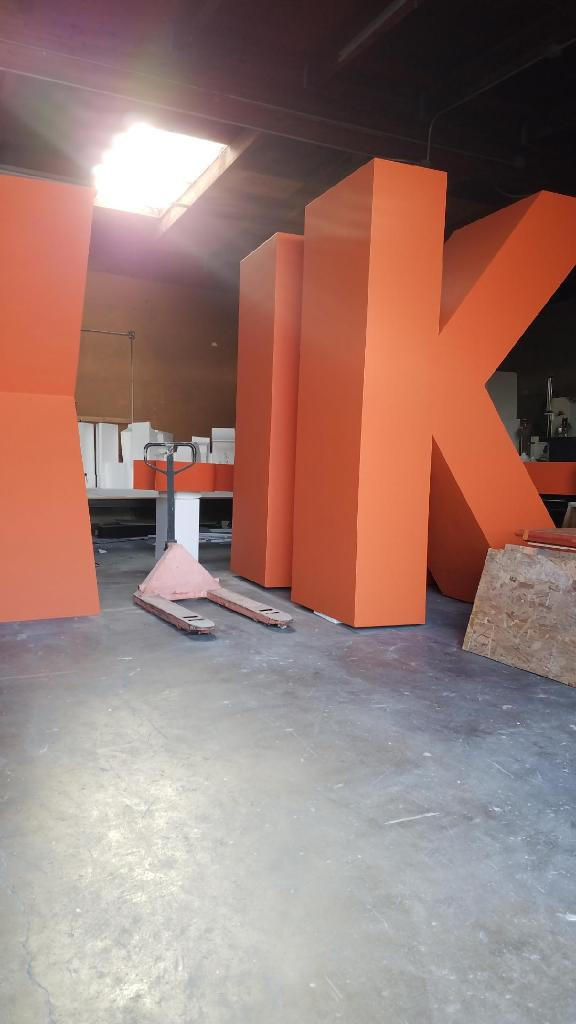 Oversize painted foam letters over 10ft tall