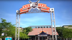 Large logo banner hanging on a metal structure