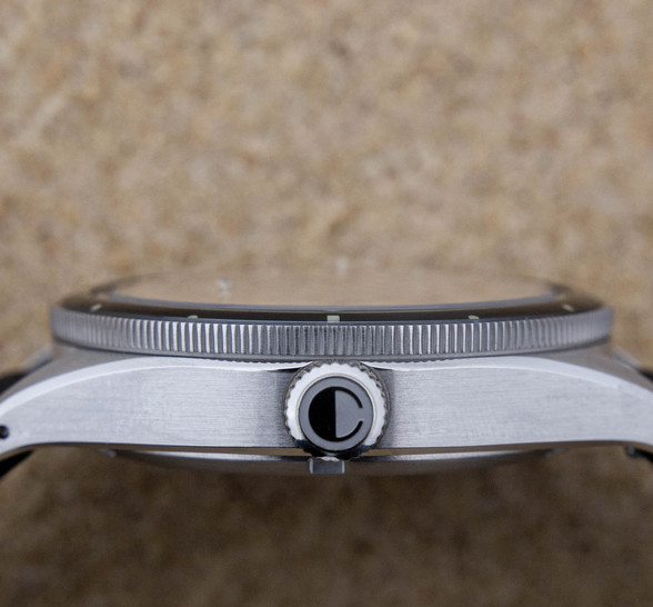 Drilled lugs of the Photic Diver, function meets form