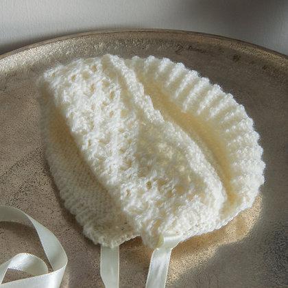 Cream knitted wool bonnet NB