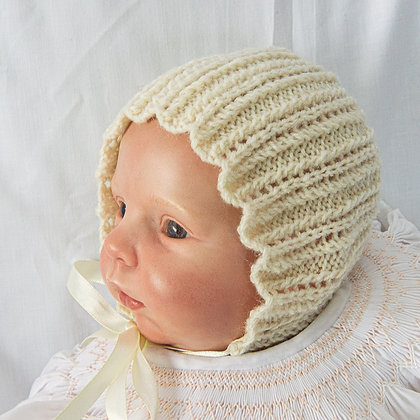 Cream hand knitted bonnets with ribbon ties