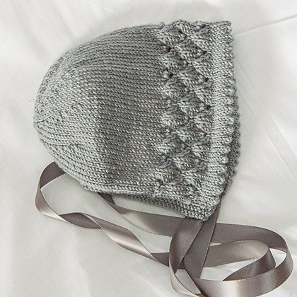 Grey hand knitted bonnets with ribbon ties