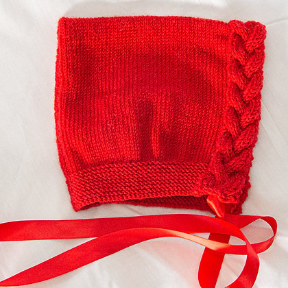 Coloured hand knitted bonnets with ribbon ties