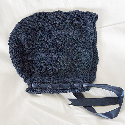 Navy hand knitted bonnets with ribbon ties
