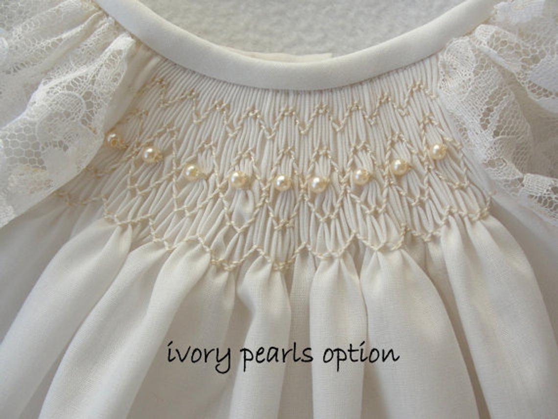 Angle sleeved smocked dress with beads.j