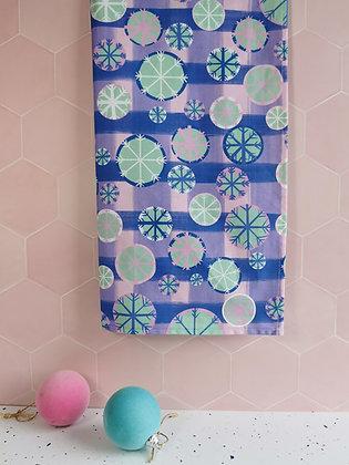Christmas snowflake tea towel in pastel colours