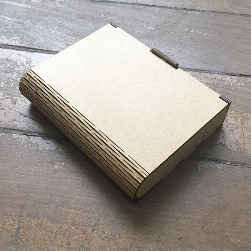 Caixa com tampa flexível