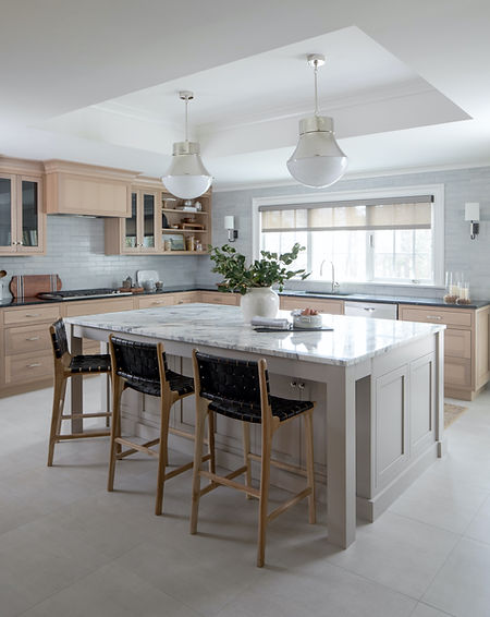 Adding a substantial sized kitchen to this Summit colonial home gives a bright and roomy feel while using timeless materials to blend with the original home.