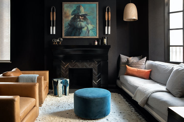 A moody palette of this townhouse creates a chic look while remaining a comfortable and inviting living space.