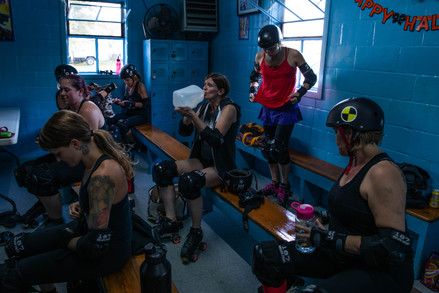 Members of the Athens Ohio Roller Derby team get equipped prior to starting their rigorous routinely practice held at Dow's Roller Arena in Nelsonville, Ohio on Tuesday, Oct. 22, 2019.