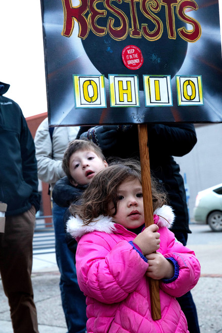 Siblings stand together in a protest organized for protection of the Robert Mueller case outside city hall in Athens, Ohio on Nov. 8, 2018.
