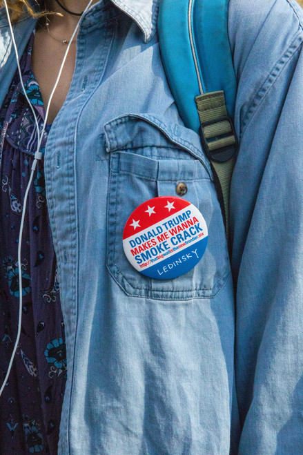 Ohio University student Emily Rodgers sports a pin on her shirt in the spirit of the Midterm Elections on Nov. 6, 2018.