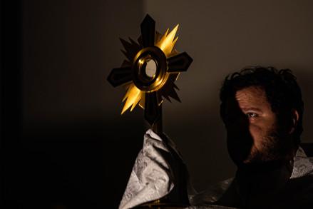 The Rev. Fr. Matthew Gossett holds the Eucharist cross during mass at Christ the King University Parish Catholic Church in Athens, Ohio, on Wednesday, Sept. 16, 2020.
