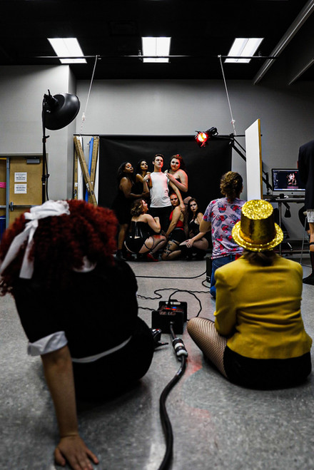 Pink Flamingo Company members switch out to watch a photoshoot for the upcoming Rocky Horror Picture Show performance in Athens, Ohio, on October 31, 2018.
