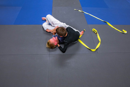 Abner wrestles with a classmate at the Academy in Athens, Ohio.