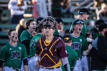 Central Michigan's catcher Griffin Lockwood-Powell (No. 21) walks away from the Bobcat's celebration over their victory after a home run ends the 12-11 game on Saturday, March 23, 2019.