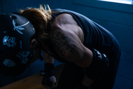 """""""Slam Funk U Up"""" straps on her knee pads before beginning a practice with the Athens Ohio Roller Derby at Dow Roller Arena in Nelsonville, Ohio on Tuesday, Oct. 22, 2019."""