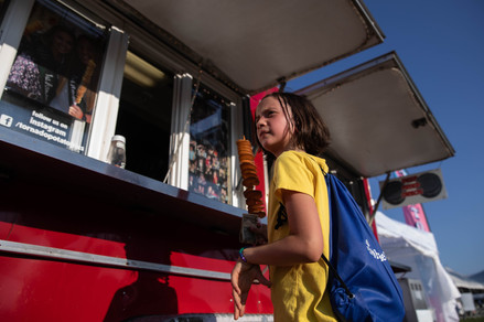 June Cook holds a potato tornado while waiting on other food she ordered at a food truck at the Pawpaw Festival in Albany, Ohio, on Friday, Sept. 13, 2019.