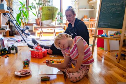 Eleanor Wedel practices math problems with her mother, Coral, in their home in Albany, Ohio, on Monday, Nov. 4, 2019. Coral switches with her husband, Matt, to homeschool their children together.