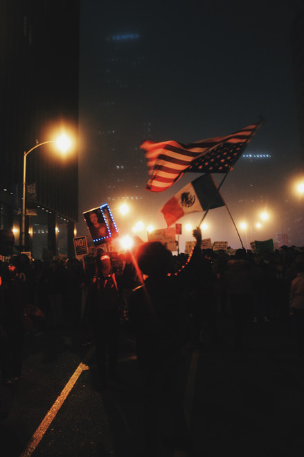 A protester waves an upside down American flag in the midst of a mass demonstration weaving through the streets of downtown Chicago immediately following President Donald Trump's Inauguration on Jan. 20, 2017.