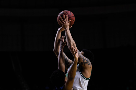 Ohio University reaches for a basket against Kent State University in a match held at the Convocation Center in Athens, Ohio.