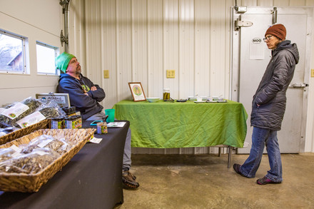 Chris and Michelle Chmiel discuss finances and the day's earnings from selling off Integration Acres products to intrigued customers traveling to the farm on Sunday, Nov. 17, 2019.