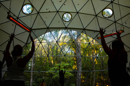 In a golden-hour-lit dome, students follow Geode Yoga + Fitness instructor Marci Hedderson-Caroll in a flow during a hot power yoga session inside its dome in Chillicothe, Ohio, on Monday, Oct. 5, 2020.