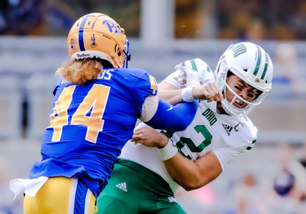 Ohio's quarterback Nathan Rourke (No. 12) is tackled by Pitt's linebacker Elias Reynolds (No. 44) in the second quarter at Heinz Field in Pittsburgh, PA on Saturday, Sept. 7, 2019.