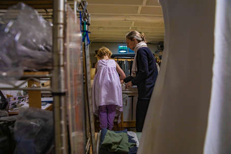 Coral helps Eleanor with cutting fabric in her work studio for a project aimed to create re-usable food bags on Tuesday, Dec. 3, 2019.