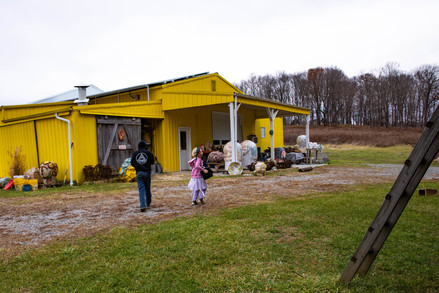 Abner and Eleanor make their way over to their father's sculpture studio to play with clay that he got for them all to work with together. Matt's studio is a work in progress that was built behind their family home in Albany, Ohio.