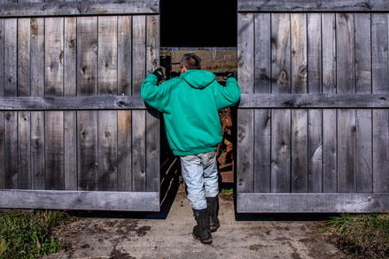 Chris Chmiel closes the doors to Integration Acres' storage shed after another day's work, marking one of the remaining days of the active season Chmiel enjoys every year on his Albany, Ohio, property.